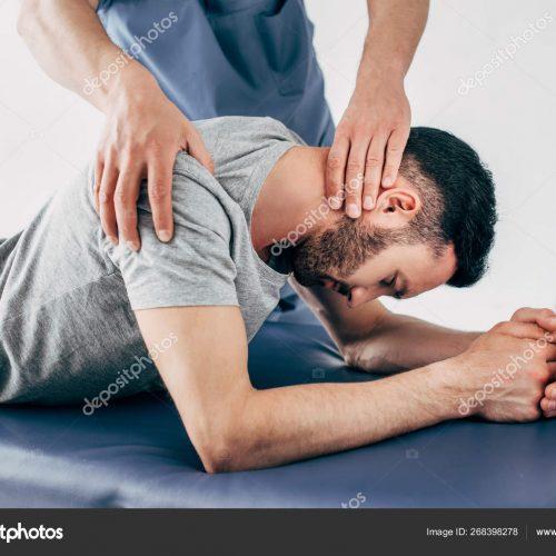 depositphotos_268398278-stock-photo-chiropractor-massaging-shoulder-neck-man