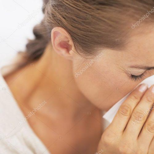 depositphotos_30055439-stock-photo-woman-blowing-nose-into-handkerchief